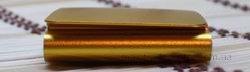 Китайский ipod nano 6g оранжевого цвета, вид слева.